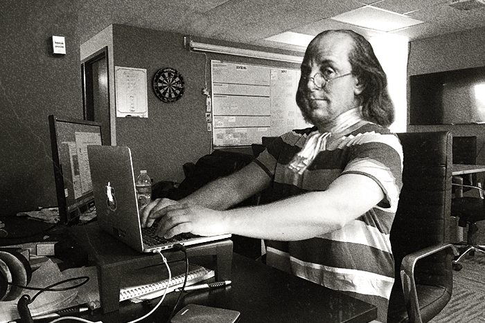 Ben Franklin at his Macbook Air