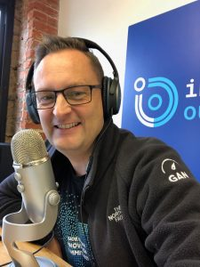 Photo of Brian Ardinger with headphones doing podcast