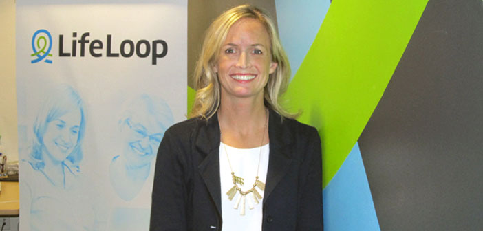 Amy Johnson in front of LifeLoop poster